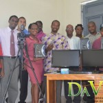 Members of the National Youth Council of Dominica with Minister of Information, Telecommunications and Constituency Empowerment, Ambrose George