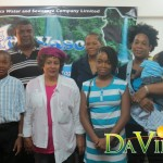 (back L-R) PRO of DOWASCO Edward Registe and human resource manager Gene Jno Bpatiste. (front L-R) Essiel Green, his mother and Nya Lockhart and her mother
